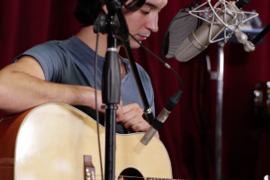 acoustic guitar and vocals at the same time